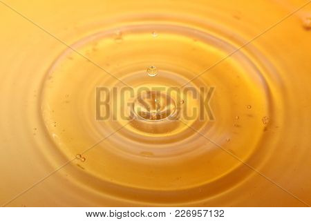 ripples on the surface of water after a drop of a liquid