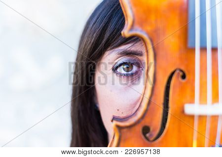 Woman Playing Violin In Studio With White Background.