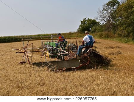 Rollag, Minnesota, Sept 2, 2017: Unidentified Operators Of A John Deere 60 Tractor A Grain Binder Ar