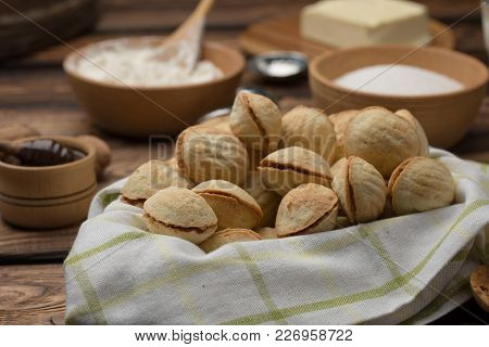 Homemade Cookies Shaped Nuts With Cream Boiled Condensed Milk With Ingredients On Wooden Table. Rust