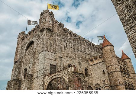 Stone Watch-tower, Walls And Flags Inside The Gravensteen Castle At Ghent. In Addition To Intense Cu