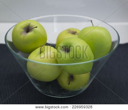 Glass Bowl With Green Granny Smith Apples On Black Napkin, White Background