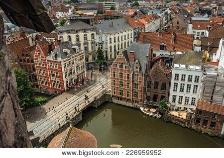 Old Buildings Seen From The Top Of Tower In The Gravensteen Castle At Ghent. In Addition To Intense