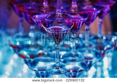 Glasses With Martini Cocktail With Ultraviolet Color Illumination