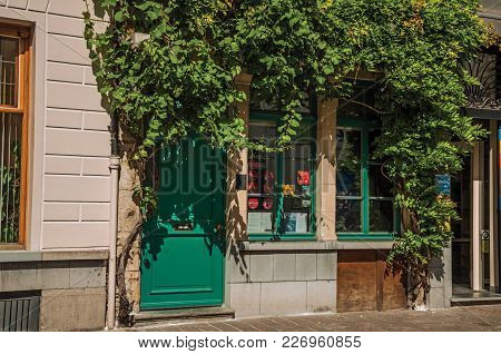 Ghent, Belgium - July 03, 2017. Restaurant Facade With Creeper In The City Center Of Ghent. In Addit