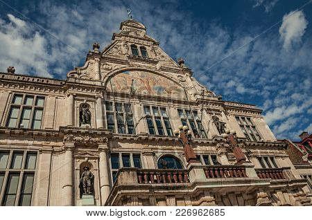 Old Classical Building With Statues And Blue Sky In The City Center Of Ghent. In Addition To Intense