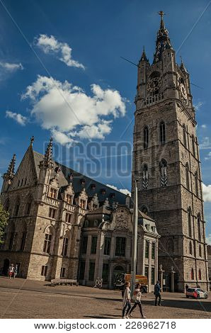 Ghent, Belgium - July 03, 2017. People, Gothic Cathedral With Clock Tower In Ghent. In Addition To I