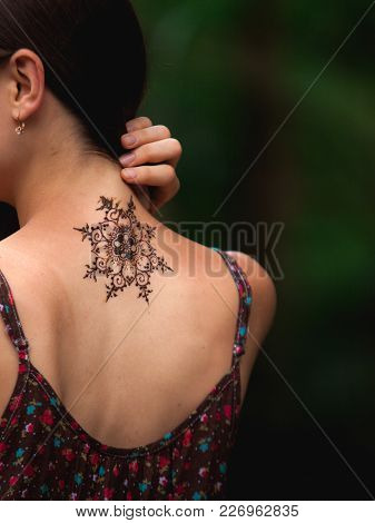 Mandala Henna Tattoo Design On A Back Side Of A Neck. Beautiful Indian Mehendi Ornaments Painted On