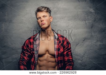 A Handsome Suntanned Male Model Dressed In A Red Fleece Shirt.