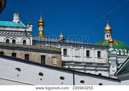 The Domes Of The Church, The Fortress Wall And Buildings In The Kiev Pechersk Lavra Of The Orthodox