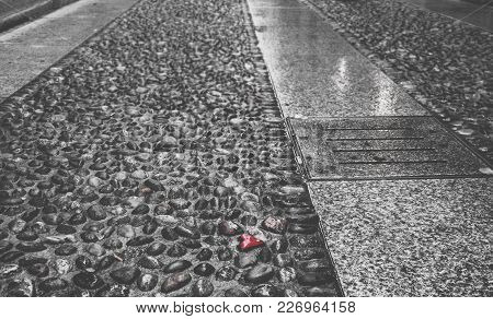 Selective Color Of Heart Shaped Pebble On Ground, Captured In Brera, Milan, Lombardy, Italy