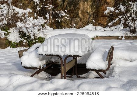 Table And Benches Covered In Snow In The Winter