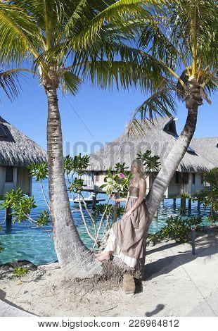 Beautiful Woman With A Rose Near A Palm Tree, Tahiti