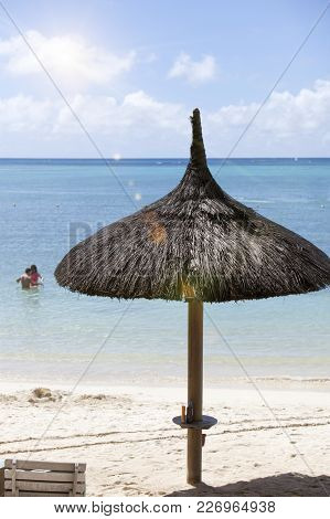 Straw Sunshade On The Beach Landscape In Sunny Day