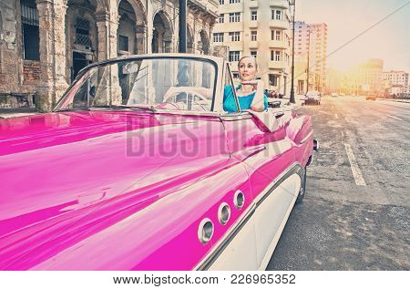 Havana- January 27, 2013: The Beautiful Woman At A Wheel Old American Retro Car (50th Years Of The L
