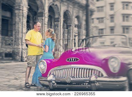 Havana- January 27, 2013: Loving Couple Near Old American Retro Car (50th Years Of The Last Century)