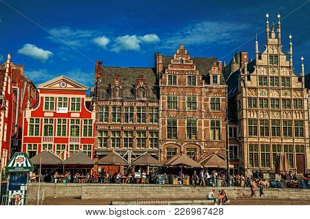 Ghent, Belgium - July 03, 2017. Old Buildings In Front Of The Canal In Ghent. In Addition To Intense