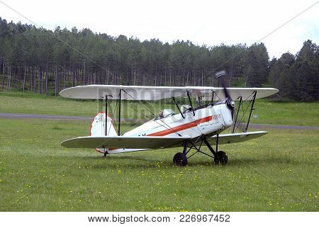 Mende, France - June 25, 2016: Landing A Biplane Rolling On The Mende Airfield In The French Departm