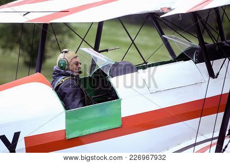 Mende, France - June 25, 2016: Pilot Of A Biplane Happy After Landing On The Mende Airfield In The F