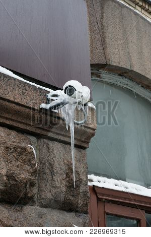 Frozen Outdoor External Security Camera With Infrared Night Vision On A Building Covered With Ice An