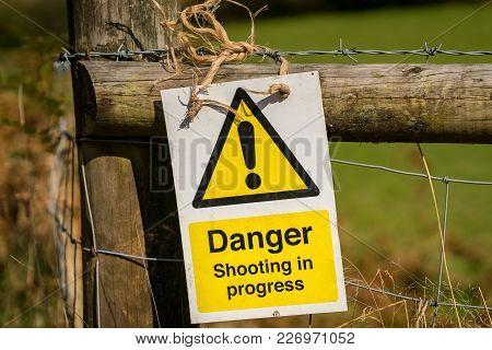 Sign: Danger Shooting In Progress, Seen Near Ystradfellte In Powys, Wales, Uk