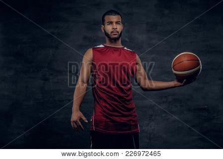 Portrait Of A Bearded Black Man Holds A Basket Ball.