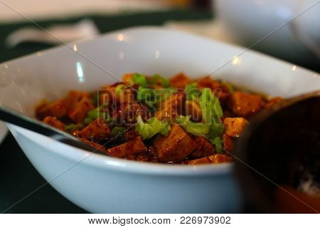 A Delicios Colourful Asian Dish In A White Plate