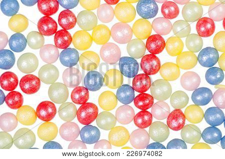 Decor For Baking Colored Pearls On A White Background, Top View