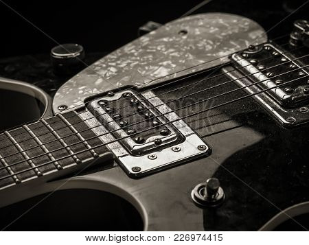 Photo Of The Pickups And Strings Of An Old Dusty Electric Guitar.