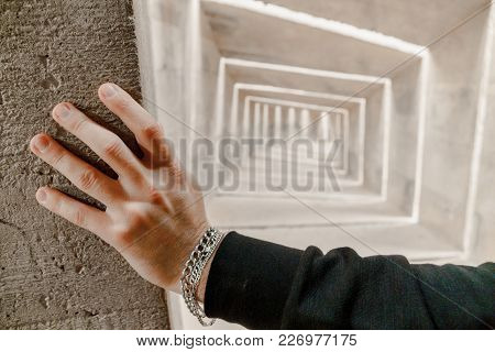 View On Caucasian Mans Hand With Bracelets Touch The Wall. He Standing, Peek And Thinking About Futu