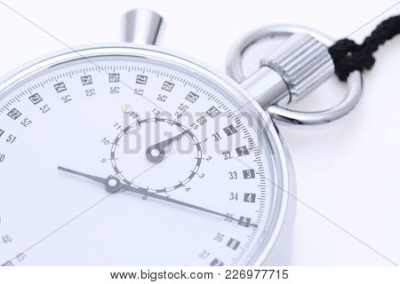 Analogue Metal Stopwatch On The White Background