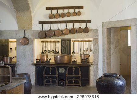 Sintra, Palace Pena, Portugal - August 08, 2017 : Copper Kitchen Utensil On The Kitchen Of National