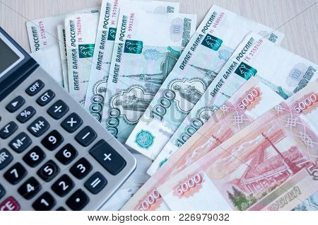 On The Table There Are Money Russian Rubles And A Calculator. Calculation Of Profit