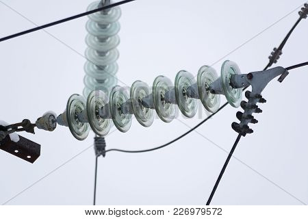 Rows Of Electrical Wires With Insulators Mounted On Bars At High Voltage Electrical Substation Again