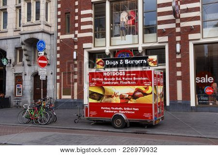 Amsterdam, Netherlands - June 25, 2017: Street Eatery With Fast Food In The Center Of Amsterdam On D