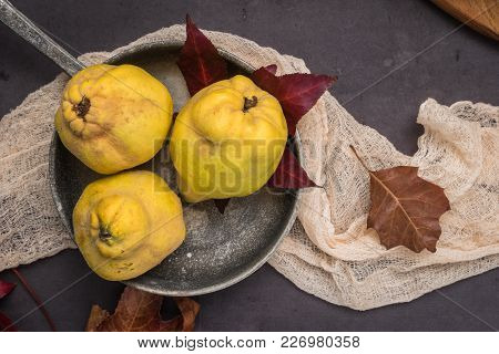 Quince Fruits And Marmelade In A Ceramic Bowl On Table Top