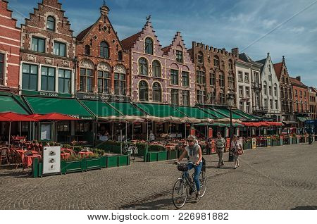 Bruges, Belgium - July 05, 2017. Building And People At The Market Square In Bruges. With Many Canal