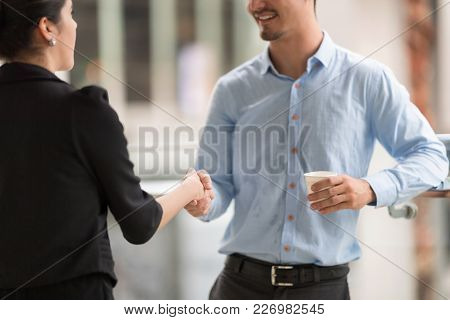 Confident Business People Are Shaking Hands After Agreeing To A Successful Job.