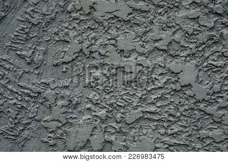 Stucco Cement Wall Texture Background In Dark Grey Color Paint.