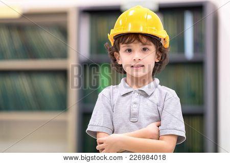 Cute Kids Wearing Yellow Engineer Helmet. Development Of Human Resources In Education Concept. Setup