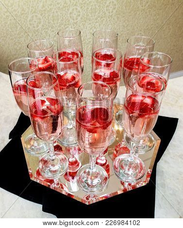 Champagne Glasses On Gold Background. Party And Holiday Celebration Concept Closeup Of Glasses Of Ch