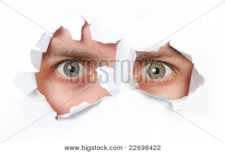 Eyes Looking Through A Hole