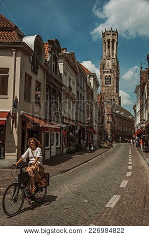 Bruges, Belgium - July 05, 2017. People And Chariot With Horse In The Streets Of Bruges. With Many C