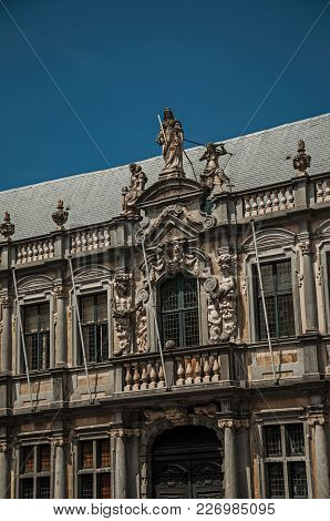 Rich And Elegant Decoration On Historic Buildings At City Center Of Bruges. With Many Canals And Old