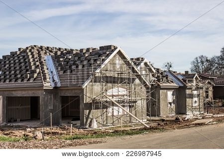 New Home Under Construction With Scaffolding For Stucco
