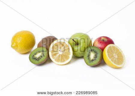 Lemon With Apples And Kiwi On White Background. Kiwi With Lemon On A White Background. Fruits On A W