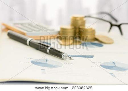Pen On Financial Report With Calculator, Money On Table Of Financial Advisor. Concept Of  Financial