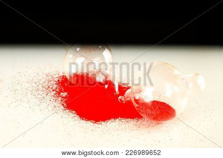 Close-up Of Broken Hourglass Object On A White Background