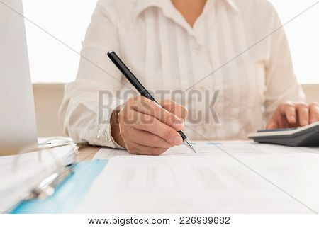 Auditor Or Internal Revenue Service Staff Checking Annual Financial Statements Of Company. Concept O