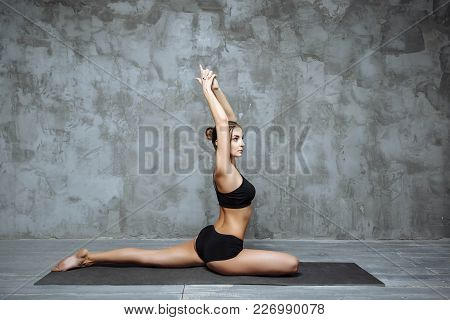 Young Attractive Woman Practicing Yoga, Stretching In One Legged King Pigeon Exercise, Eka Pada Raja